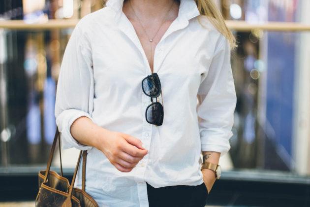 White shirt, lariat necklace